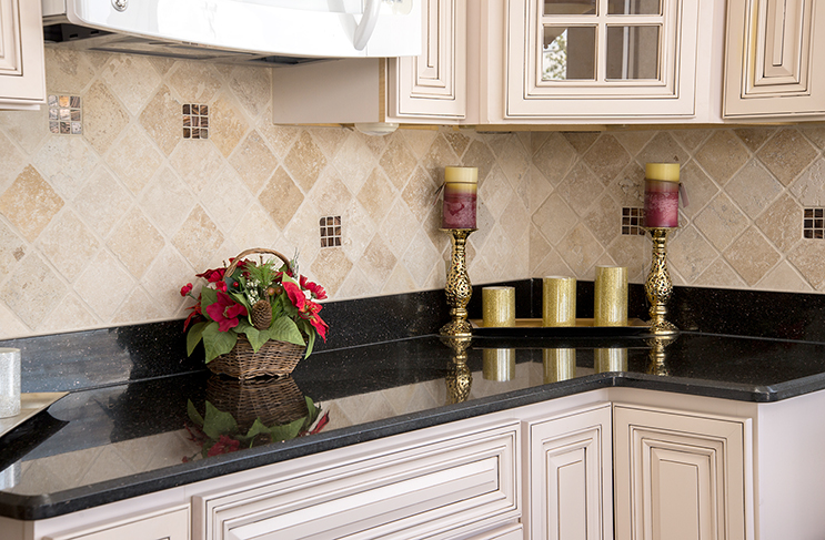 Black Galaxy Granite countertop with a travertine tile backsplash