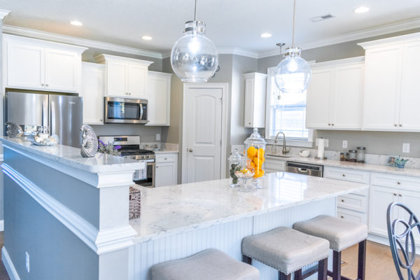 Arctic Ivory Quartz kitchen countertop tiered with bar