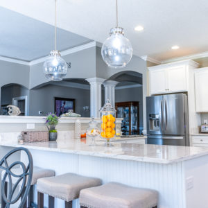 Arctic Ivory Quartz kitchen island with dining space
