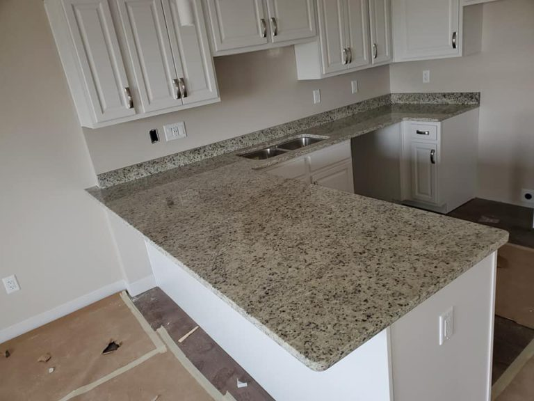 Moon Light granite kitchen countertops paired with modern white cabinets