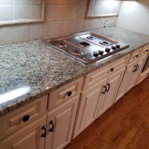 Santa Cecelia Granite Kitchen Countertops Travertine Backsplash Cream Cabinets