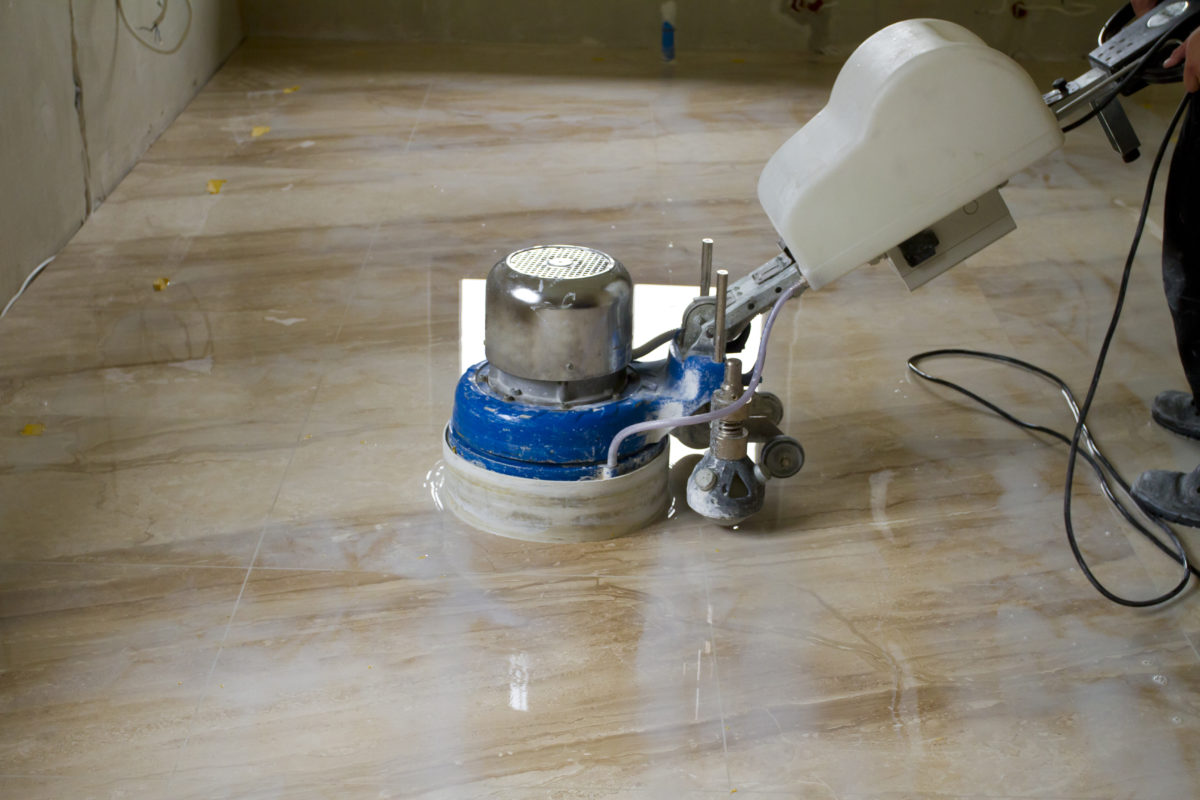Cream Marble Being Ground Into Polished Finish